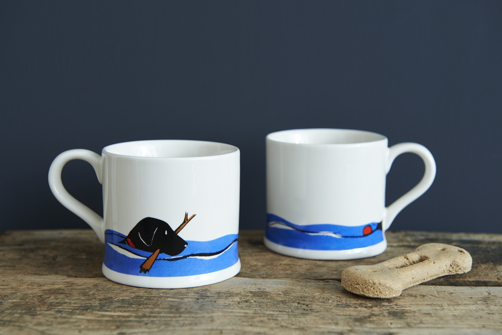 Two sides of the Black Labrador Lab swimming mug