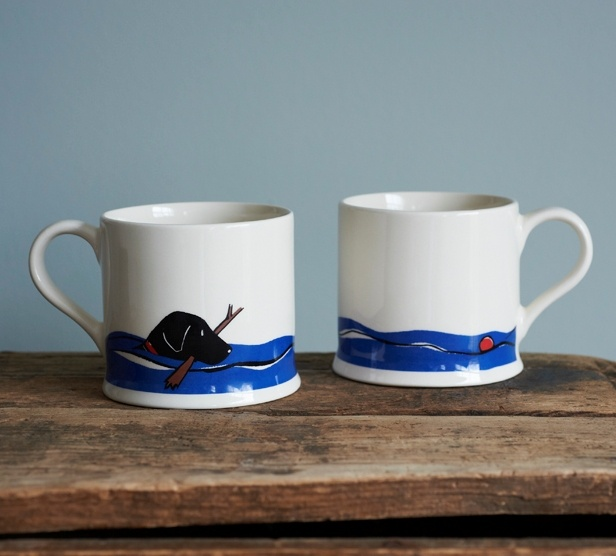 Either side of the Black Labrador Lab swimming mug from Sweet William