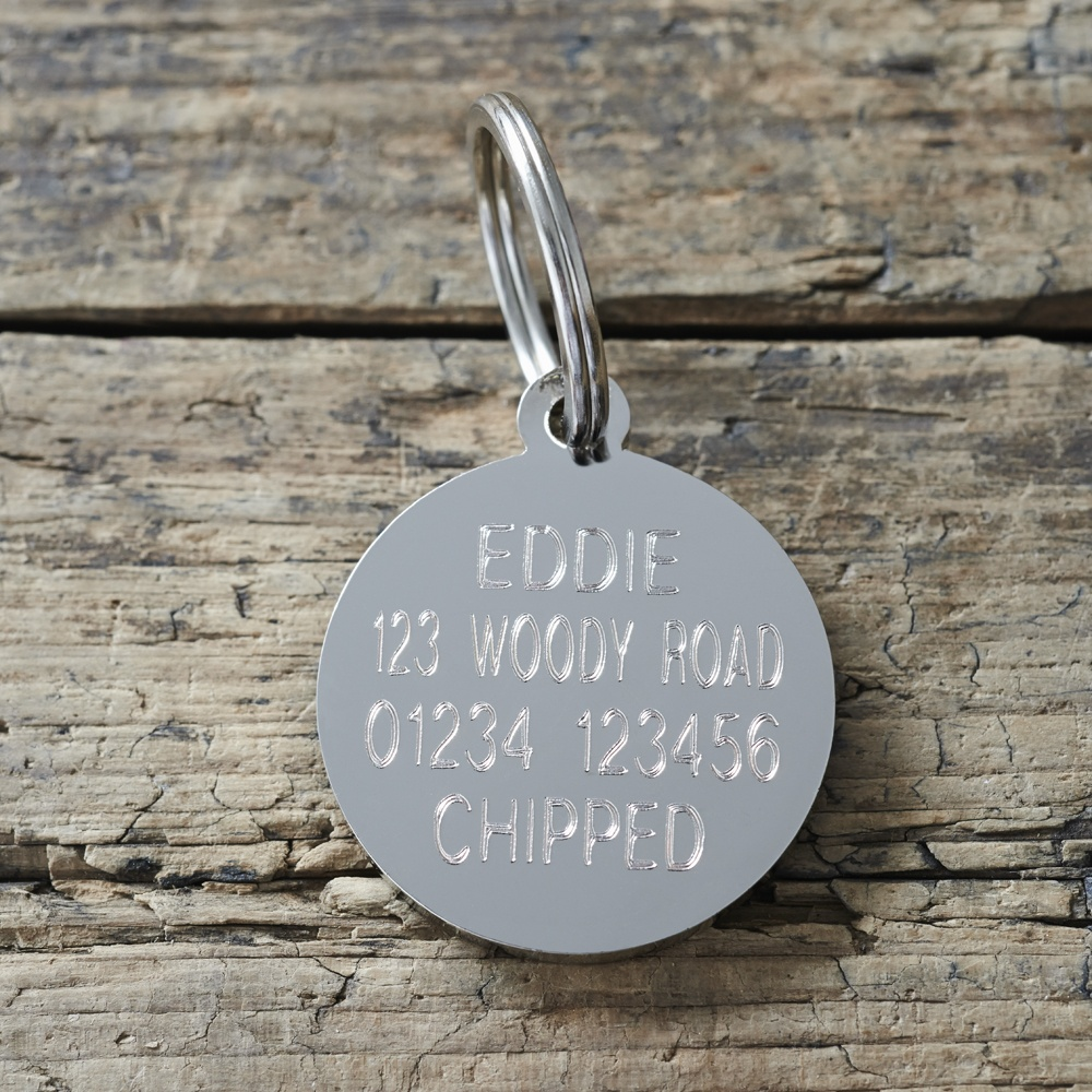Example of the engraved  reverse side of a Border Collie dog ID tag with gift box